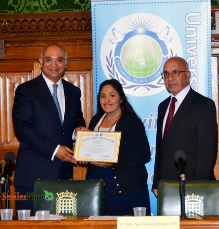Neerali Pattani is presented with a Youth Achievement Award by Rt Hon Keith Vaz MP, Mr Virendra Sharma MP (on right)