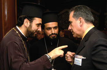 MEPI's Antonio Betancourt and Orthodox Christian priests in Gaza engage in a warm debate.