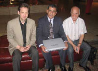Presenting a laptop for telemedicine at Allia Government Hospital Hebron, Robin Marsh, Dr Omar Al-Alool and David Sasson.