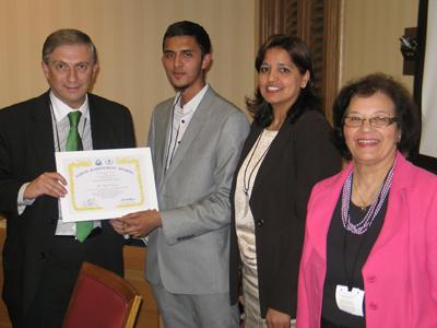 Tasif Zaman receiving an award
