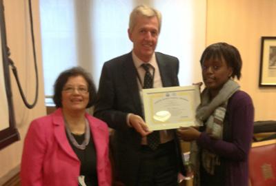 Tolu Williams receiving Award from Nick de Bois MP