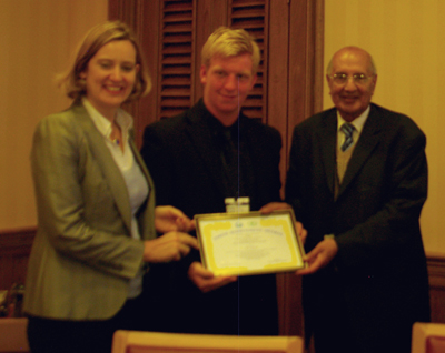 Oli Fawcett receiveing an Award from Amber Rudd MP and Lord King