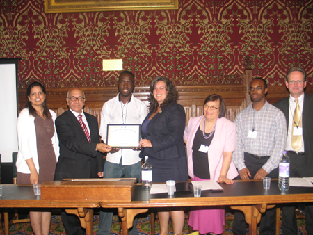 Saidi Kawooya presented with a Youth Achievement Award by Heidi Alexander MP